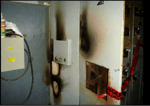 Fire damage on parts of a wall and hinged door.